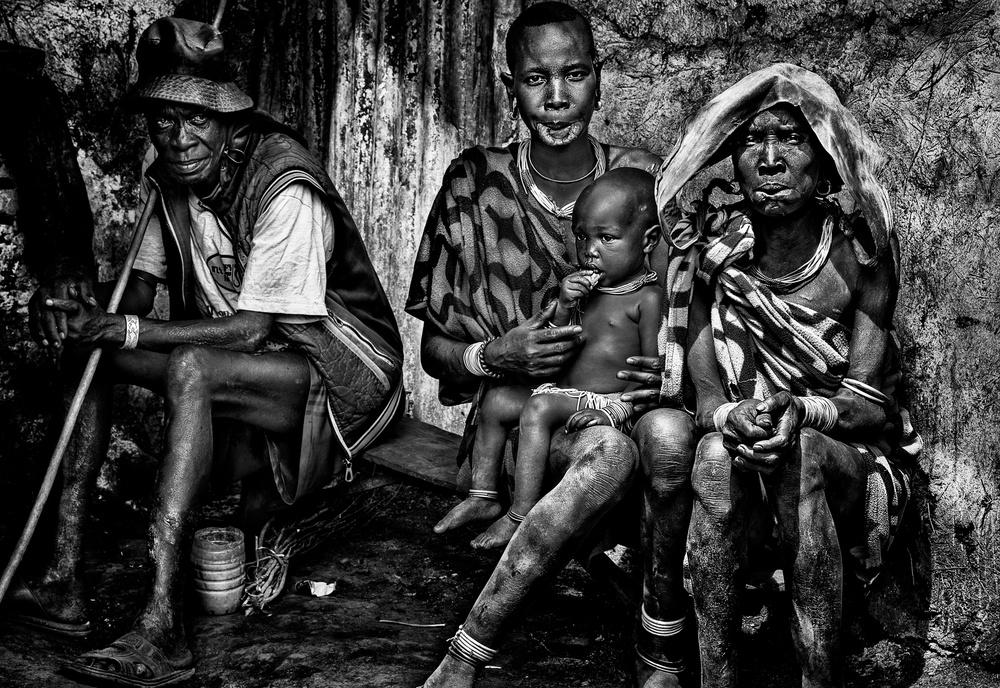 A piece of fine art art photography titled Surma Tribe Family - Ethiopia by Joxe Inazio Kuesta Garmendia