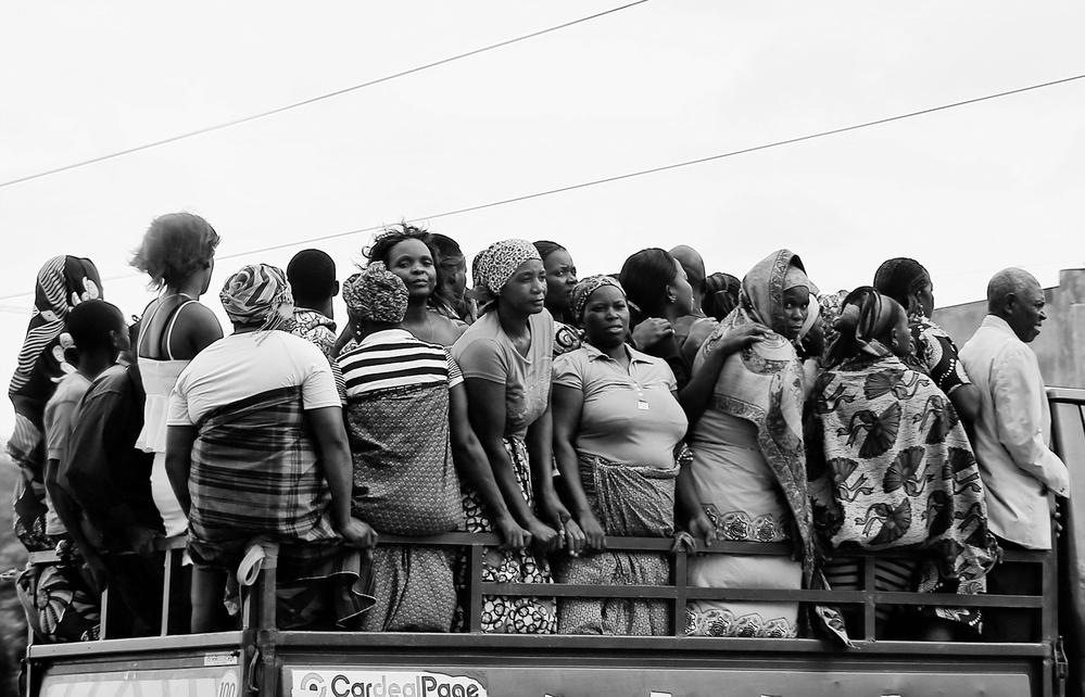 A piece of fine art art photography titled Women In Truck by Leonardo Monteverde
