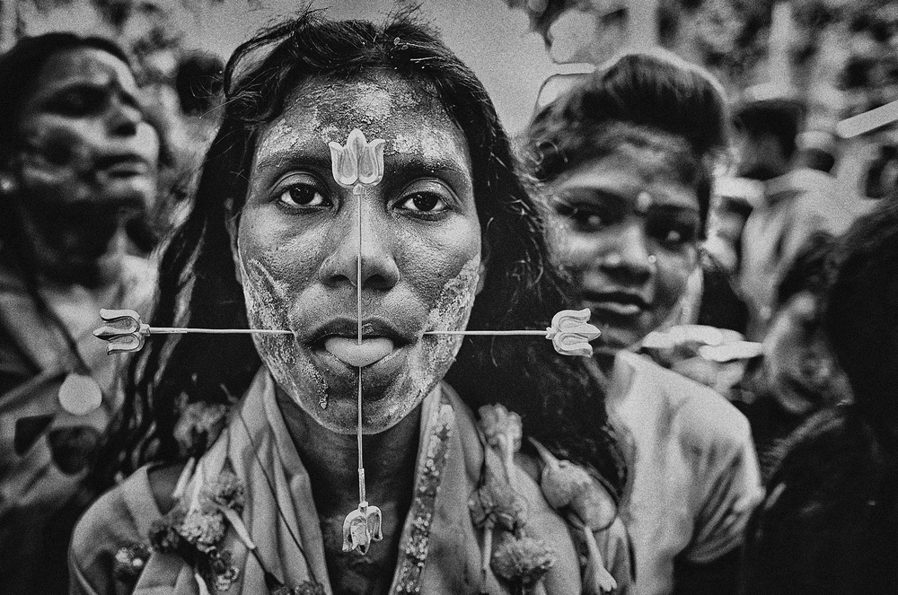 A piece of fine art art photography titled Pierced Devotee by Avishek Das