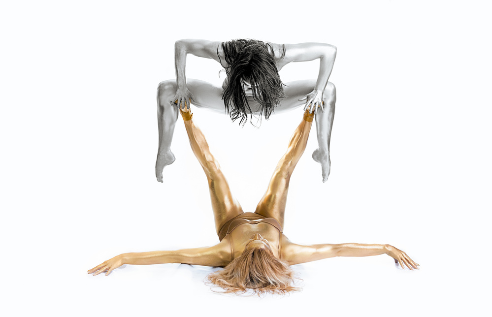 A piece of fine art art photography titled Silver On Gold - Gymnast Series by Howard Ashton-Jones