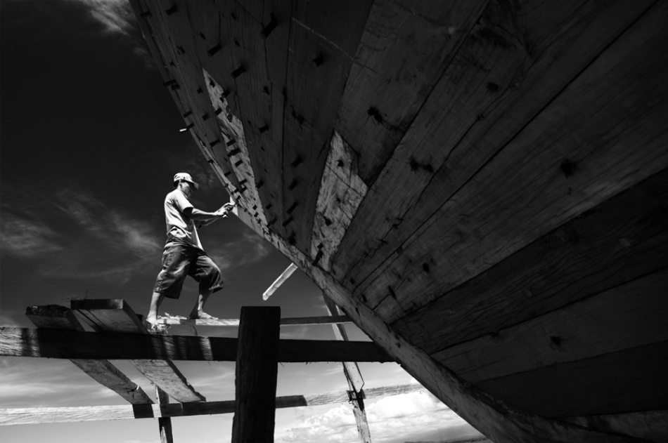 A piece of fine art art photography titled Phinisi Shipbuilders by Thaib Chaidar