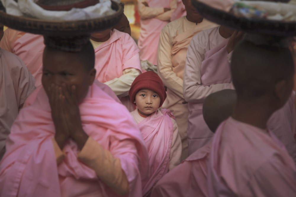 A piece of fine art art photography titled The Alms Round of Buddhist Nun by Marcus Lee