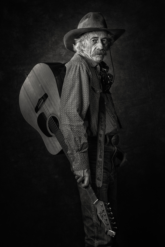 A piece of fine art art photography titled Einstein Plays Guitar by Ross Oscar