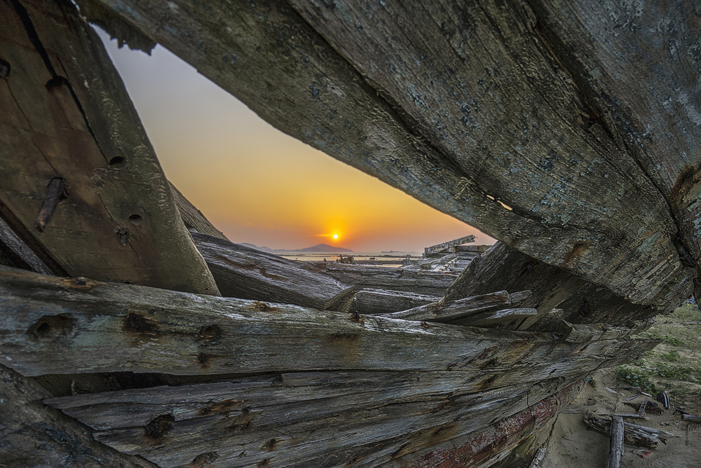 A piece of fine art art photography titled Sunrise Among Ruins of Ship by Handi Nugraha