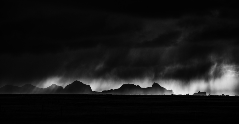 A piece of fine art art photography titled Passing Storm Over the Westmanayer Islands by Peter Svoboda, MQEP