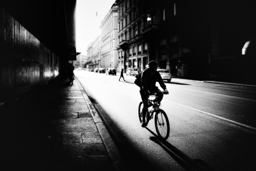 A piece of fine art art photography titled Urban Cyclist by Massimiliano Mancini
