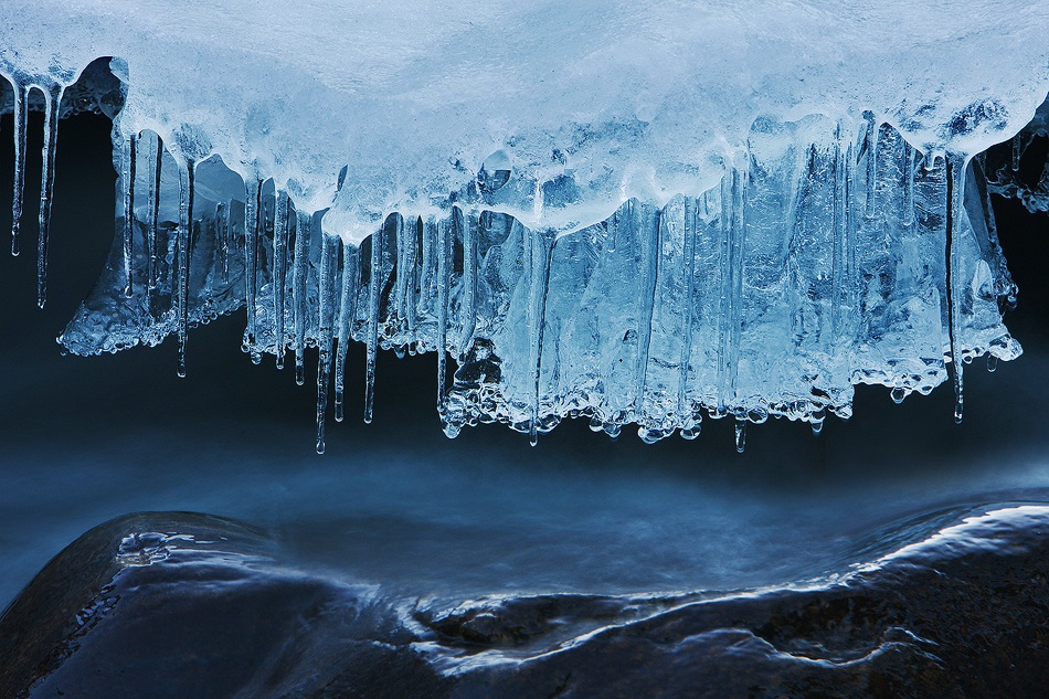 A piece of fine art art photography titled Ice Over Flow by Doug Roane