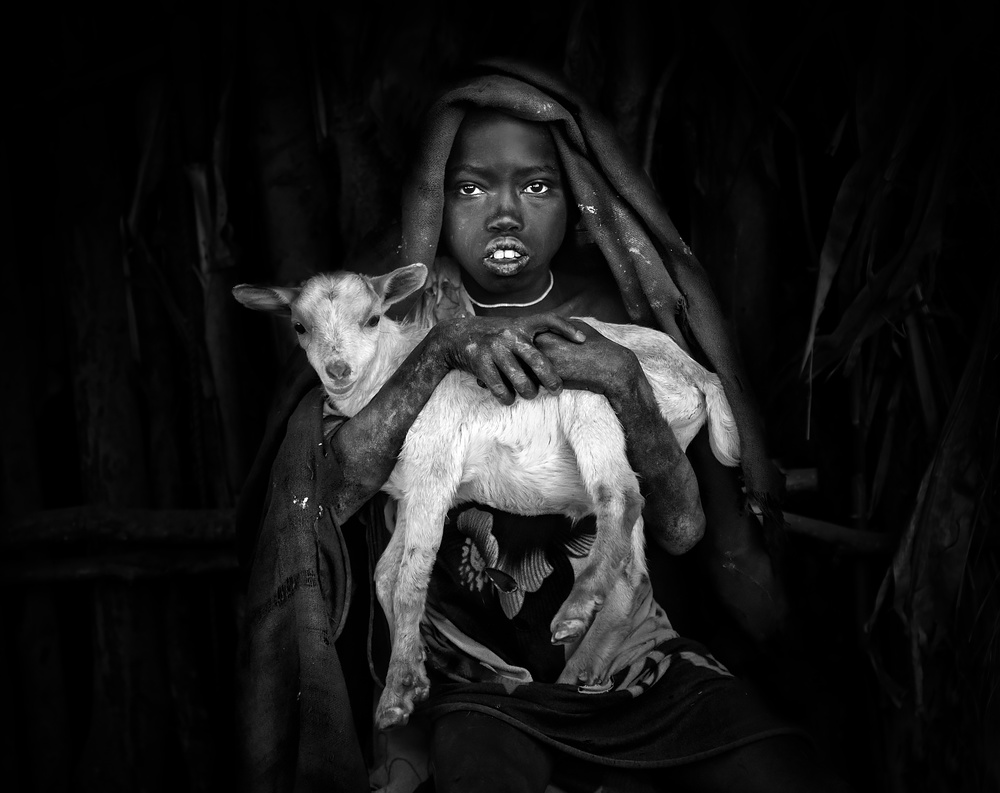 A piece of fine art art photography titled The Boy and the Goat by Juan Luis Duran
