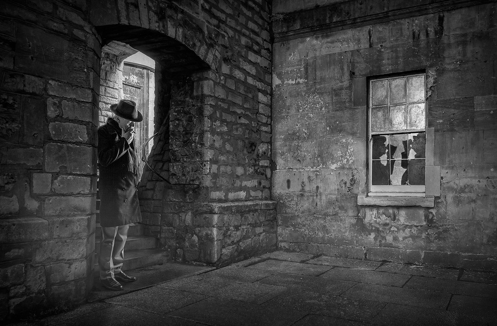 A piece of fine art art photography titled In Lonely Cities Live Lonely Men 3 by Adrian Donoghue