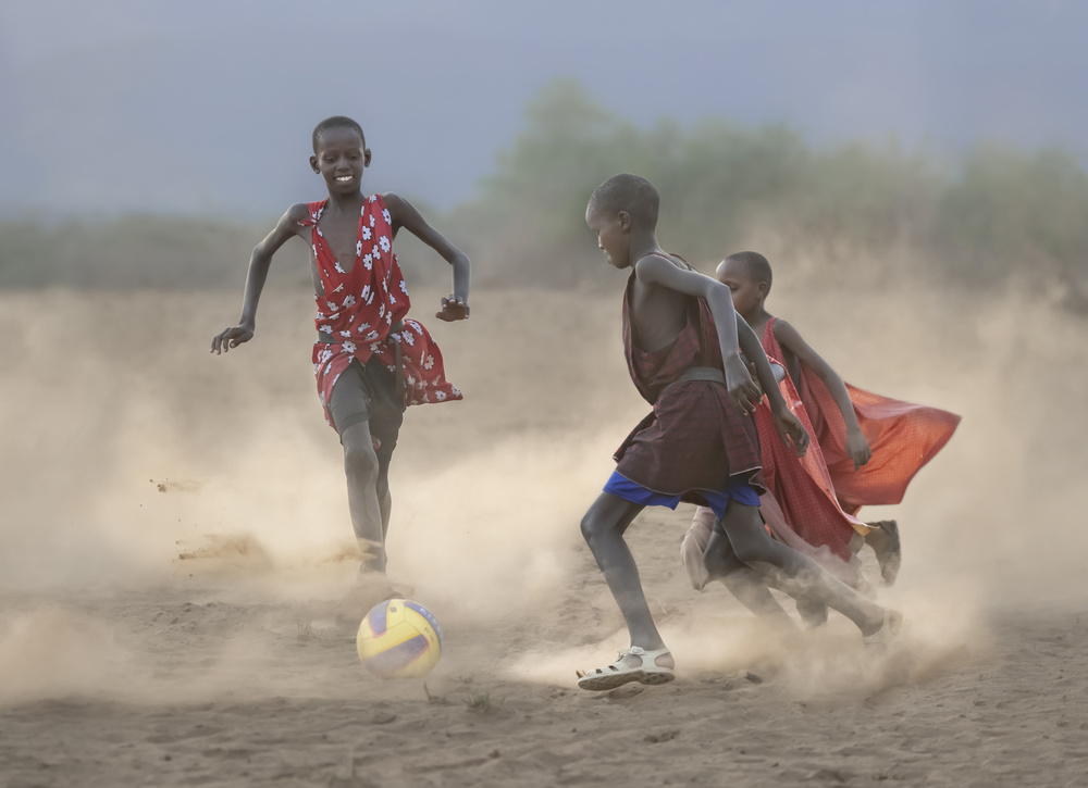 View this piece of fine art photography titled Masai children playing soccer by F. Dilek Uyar