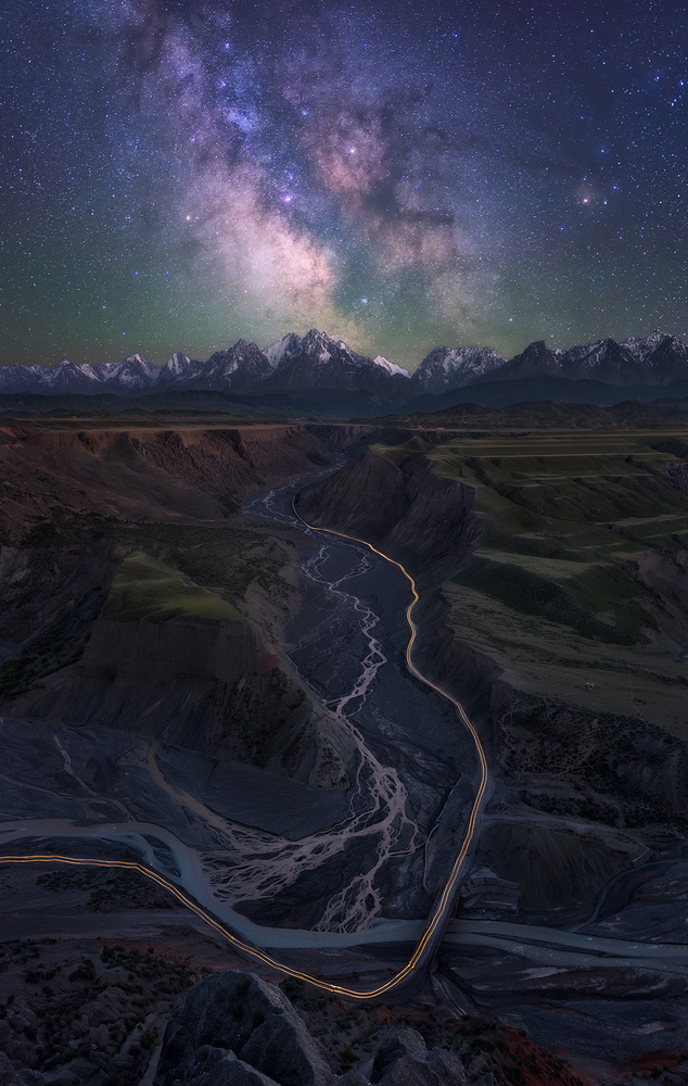 A piece of fine art art photography titled The Milky Way Over Anjihai Grand Canyon by Wenmin Zhang