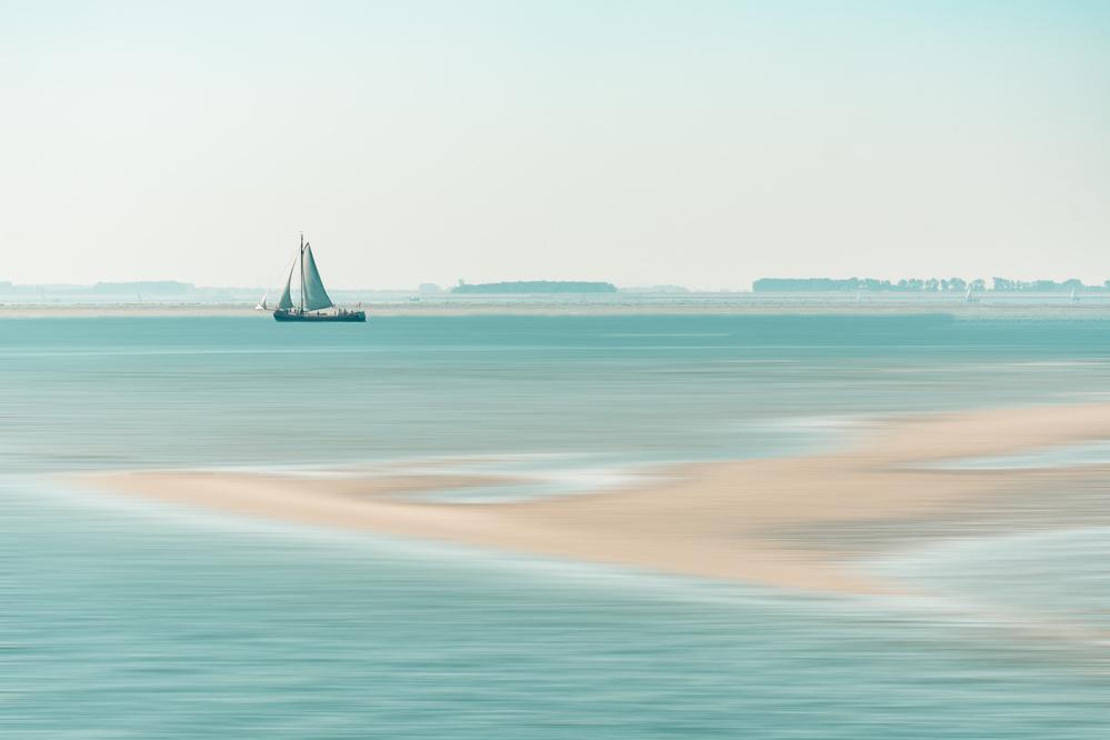 A piece of fine art art photography titled Passing a Sandbank by Bernardine de Laat