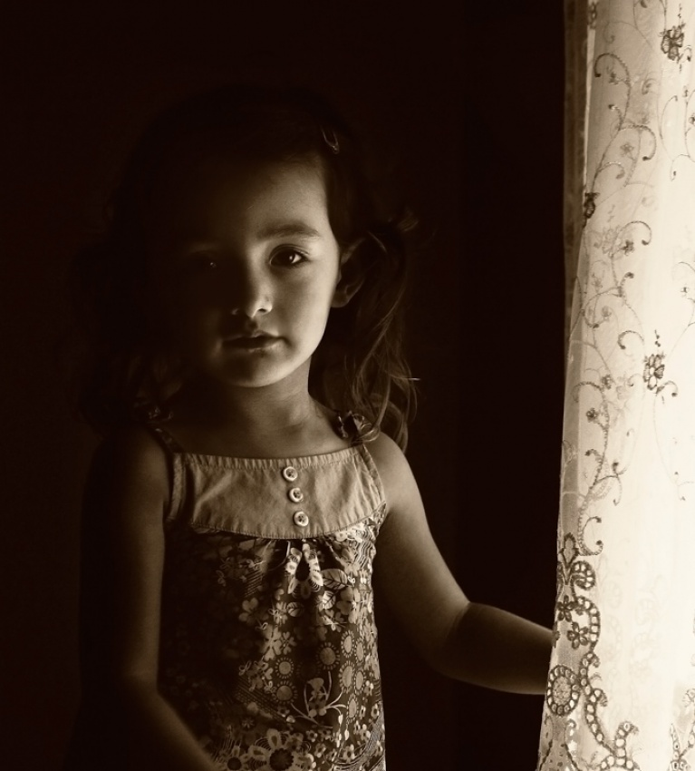 girl by the lace curtain