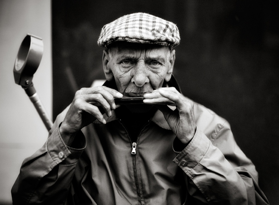 A piece of fine art art photography titled Harmonicman by moses stell