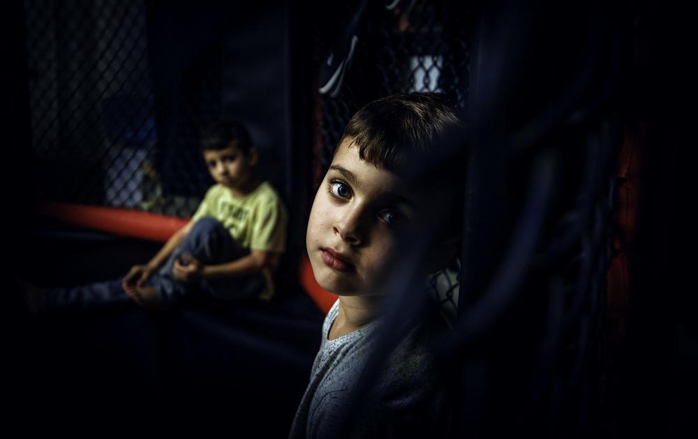 Looking kid behind the net