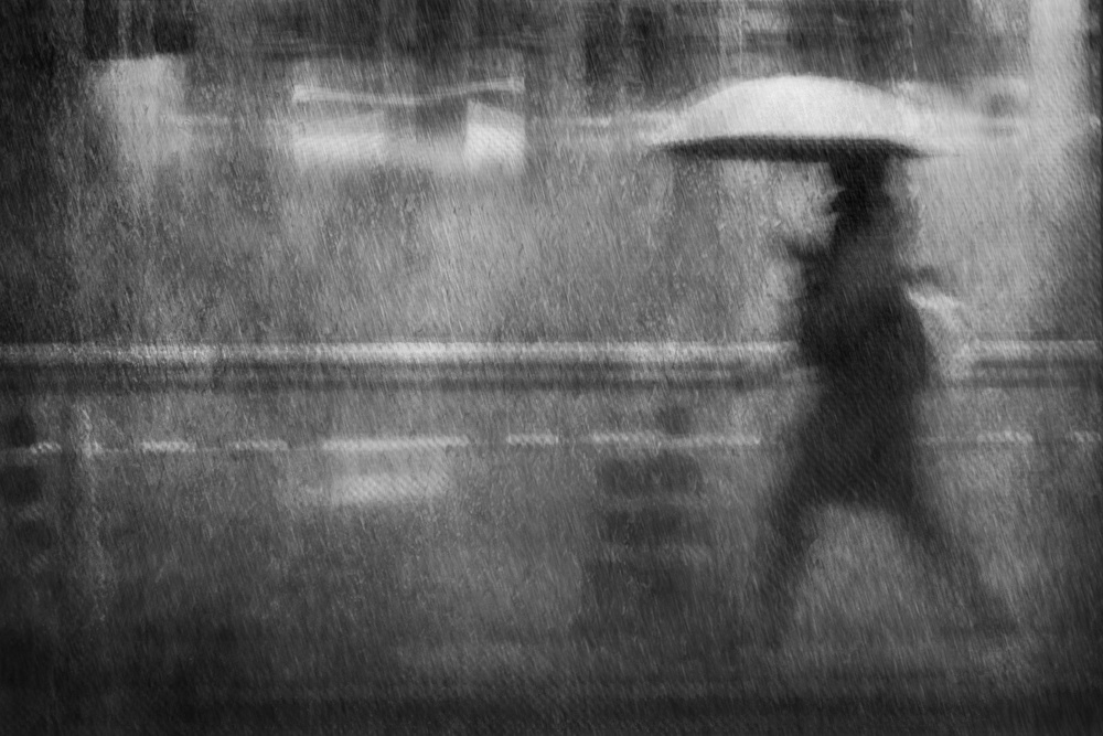 A piece of fine art art photography titled Rainy Walker by Ekkachai Khemkum