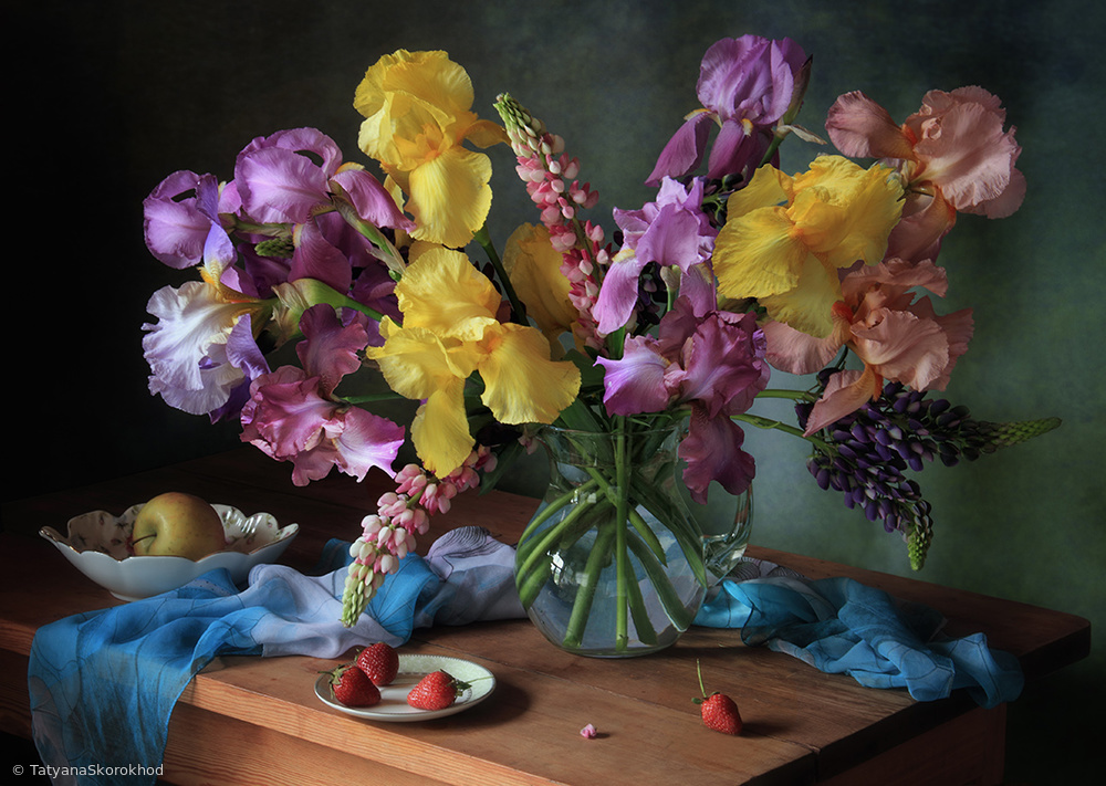 Still life with a bouquet of irises and lupine