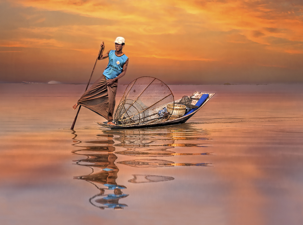 A piece of fine art art photography titled Fisherman On Inle Lake by Herbert A. Franke
