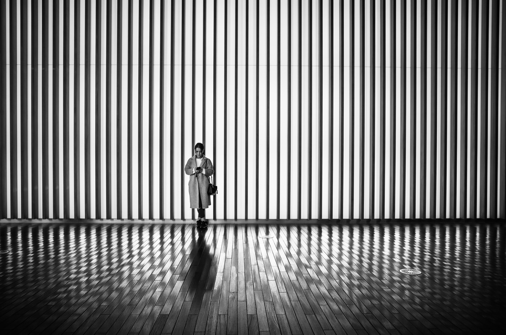A piece of fine art art photography titled Woman Waiting by Tetsuya Hashimoto