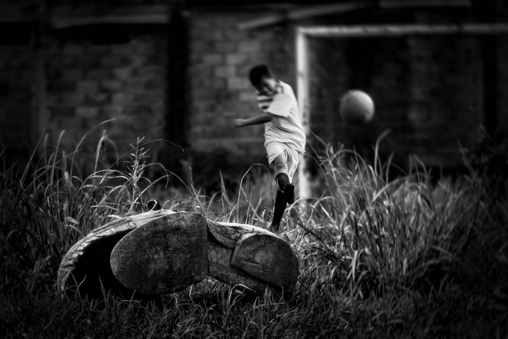 A piece of fine art art photography titled The Game Must Go On by Hadrani Hasan
