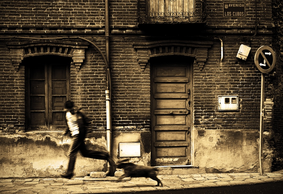 A piece of fine art art photography titled Boy Running With a Dog by Cesar Bermudez