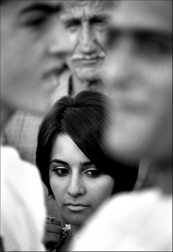 A piece of fine art art photography titled Girl In the Crowd by Balazs Pataki