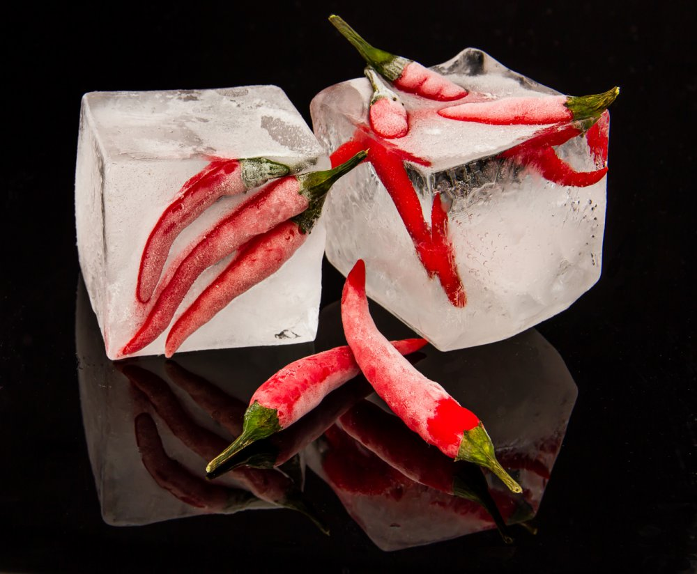 A piece of fine art art photography titled Frosty Chillies by Nicole Dittus