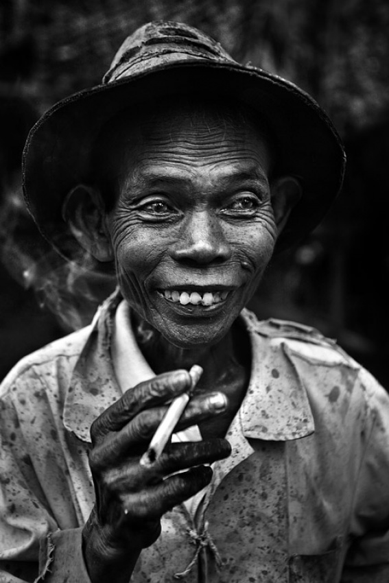 A piece of fine art art photography titled East Javanese Farmer by Mitchell Kanashkevich