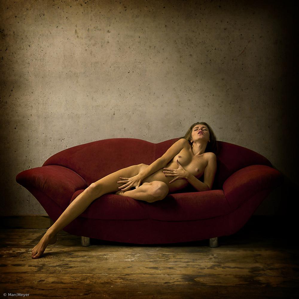On the red sofa: Masha