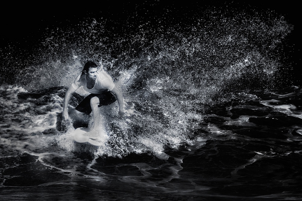 A piece of fine art art photography titled Surfing by Handi Nugraha