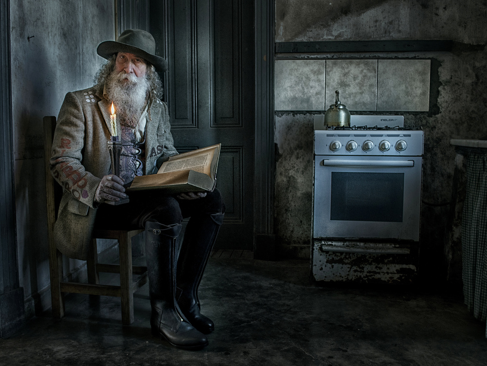 A piece of fine art art photography titled Reading In the Kitchen by Hans Wolfgang Müller