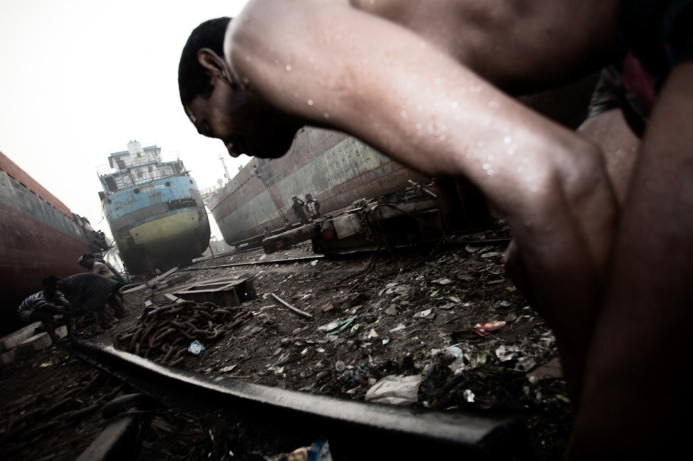 A piece of fine art art photography titled Workers, Dhaka Portual Area from HOMELAND Bangladesh 2012 by Stefano Stranges