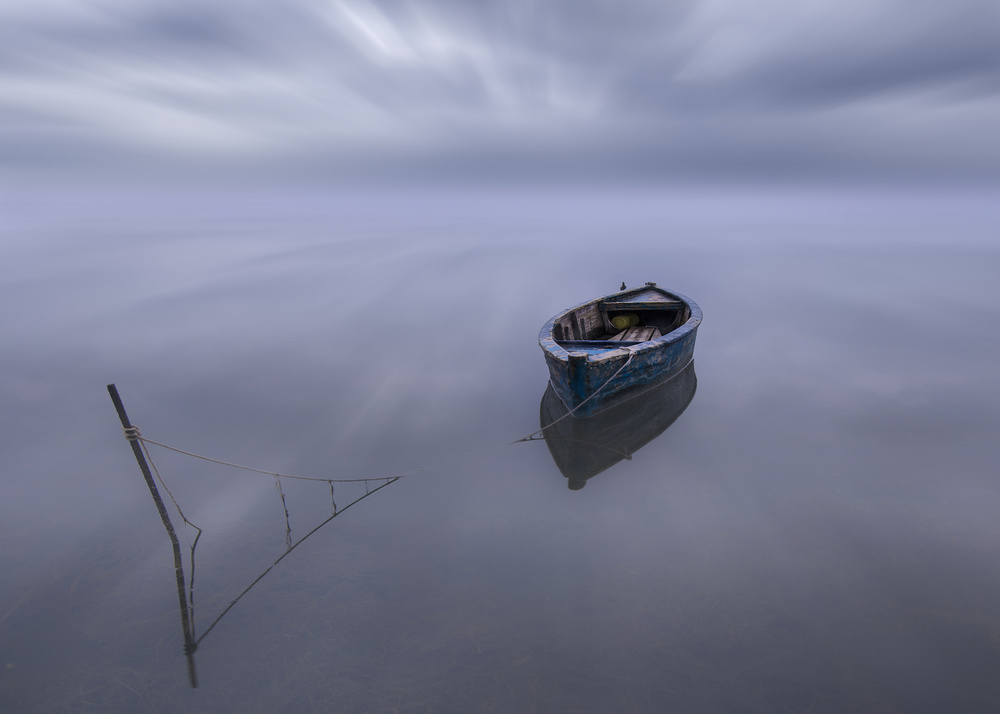 A piece of fine art art photography titled The Blue Boat by Joaquin Guerola
