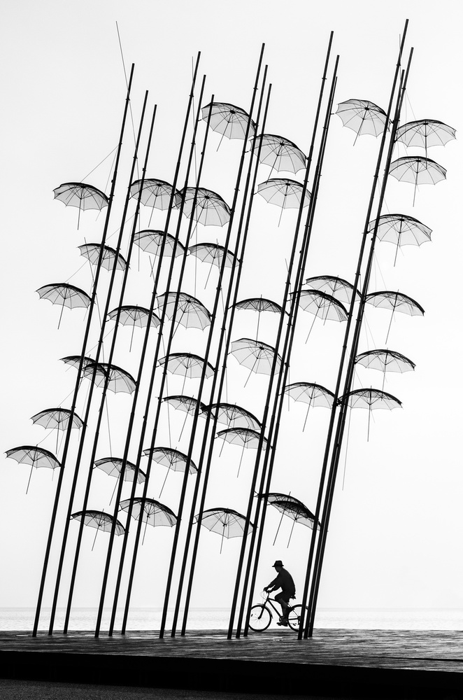 A piece of fine art art photography titled Under the Umbrellas by George Digalakis