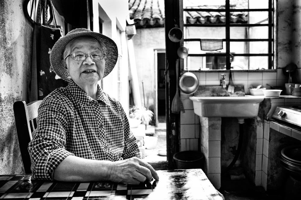 A piece of fine art art photography titled Mrs Yao In Her Kitchen by Robert