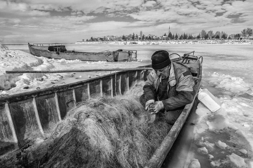 A piece of fine art art photography titled Fisherman by Murat OZEL