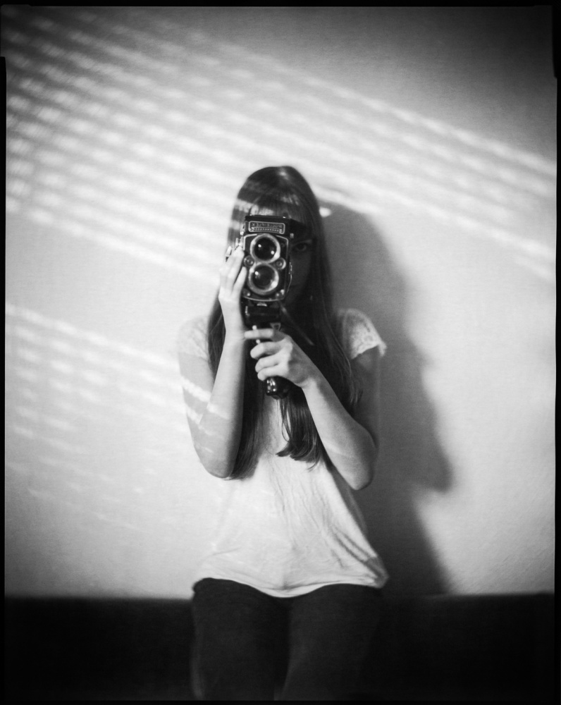 A piece of fine art art photography titled Girl With a Rolleiflex by Matthias Leberle