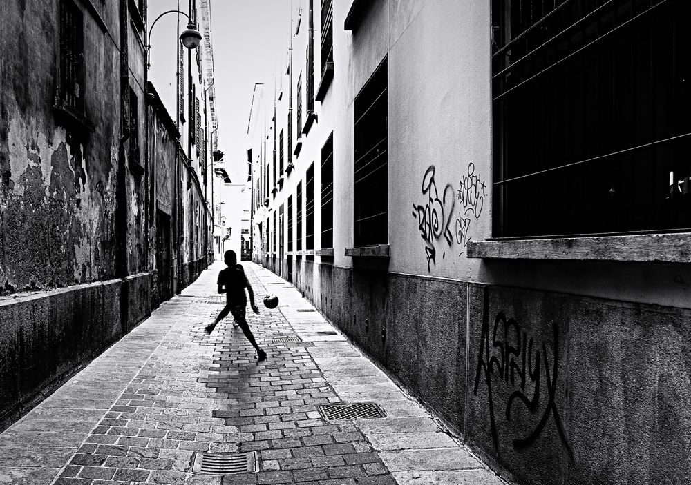 View this piece of fine art photography titled Street games by Julien Oncete
