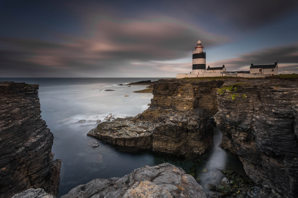 A piece of fine art art photography titled Lighthouse On Cliffs by Grzegorz Wanowicz