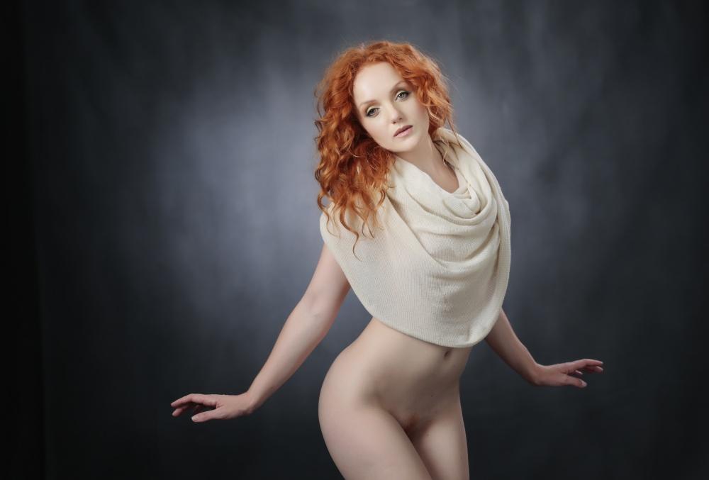 A piece of fine art art photography titled Ivory Body Sock by Ross Oscar