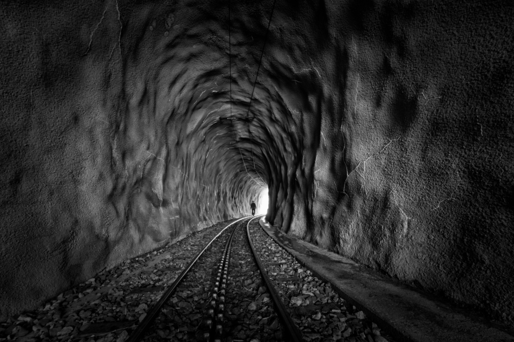 A piece of fine art art photography titled In the Bowels of the Mountain-BW by Vito Guarino