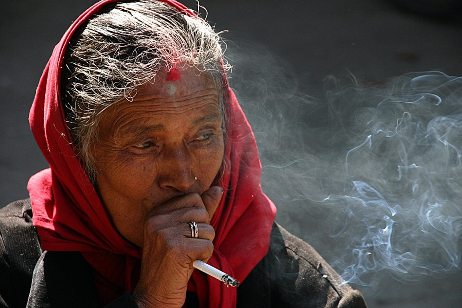 A piece of fine art art photography titled The Nepalese Way of Smoking by Helmut Schadt