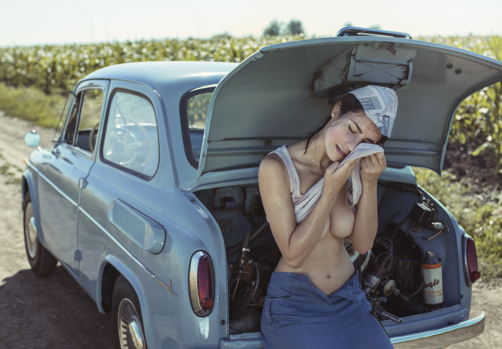 Field, heat, girl and car.