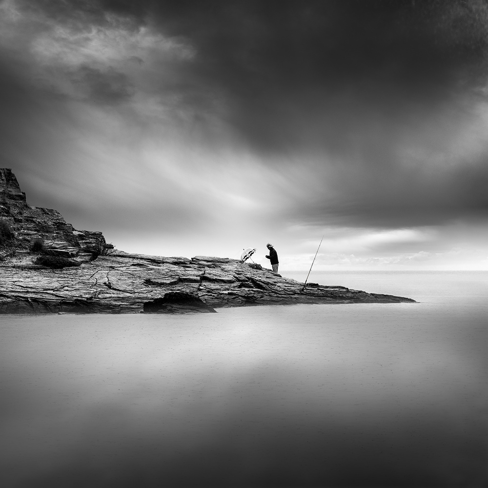 A piece of fine art art photography titled Fishing In the Rain by George Digalakis