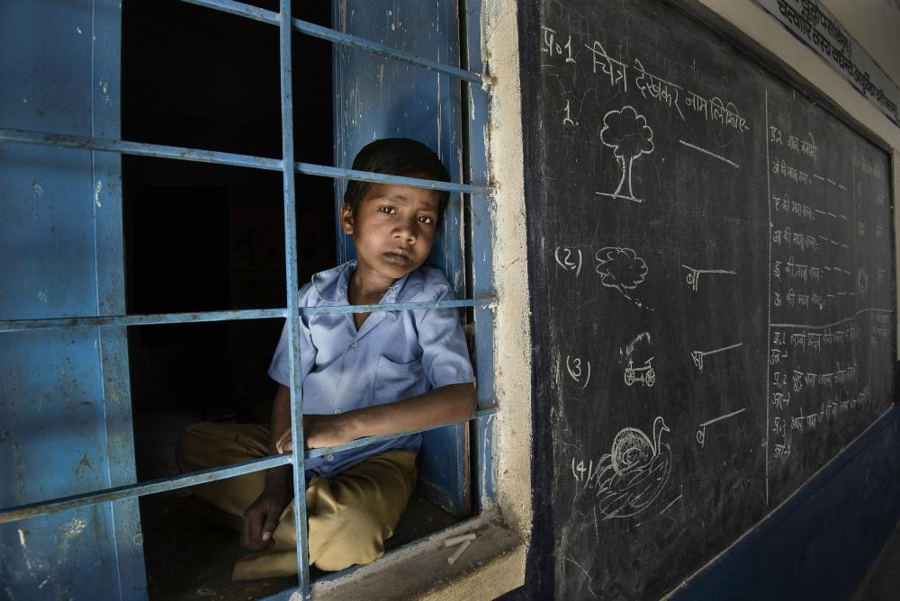 A piece of fine art art photography titled Sad Boy In School by Sajedah Al-Asfoor