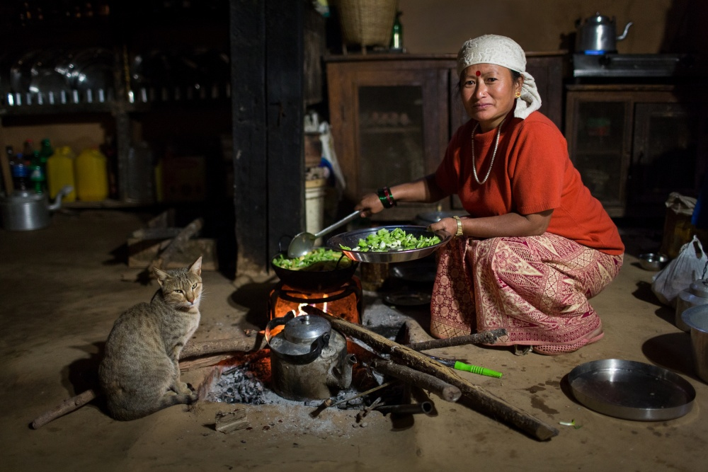A piece of fine art art photography titled Traditional Nepal Woman Cooking by Dan Mirica