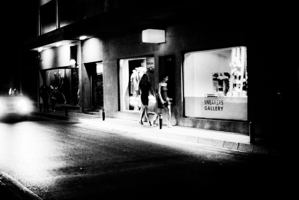 View this piece of fine art photography titled night pulse / street reflect by Lara Kantardjian