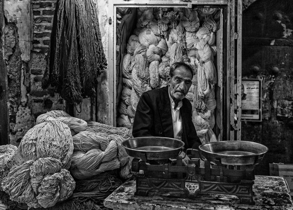 A piece of fine art art photography titled Rope Seller In a Bazaar (Iran) by Joxe Inazio Kuesta Garmendia