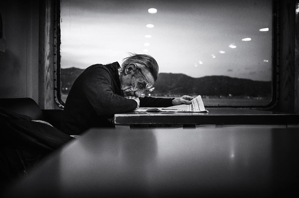 A piece of fine art art photography titled Reading by Enzo Penna