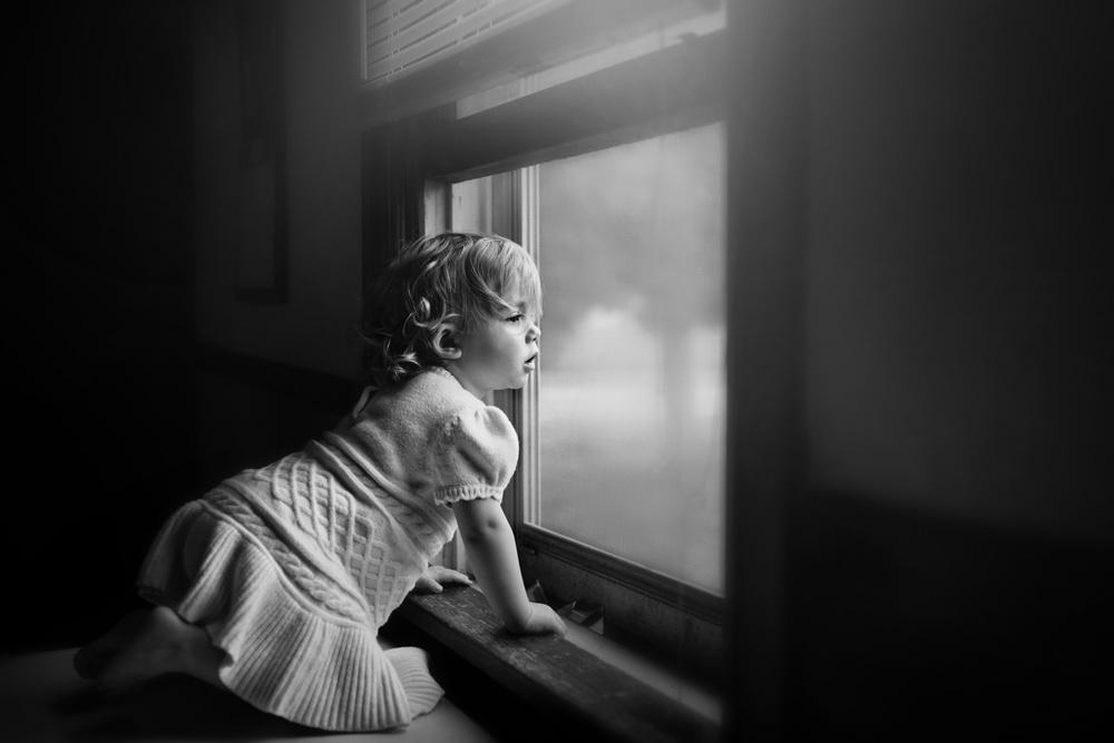 A piece of fine art art photography titled Window Watching by Kapuschinsky